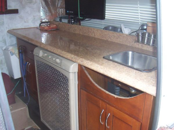 front kitchen travel trailer oak and white table boler happy campers camper interior