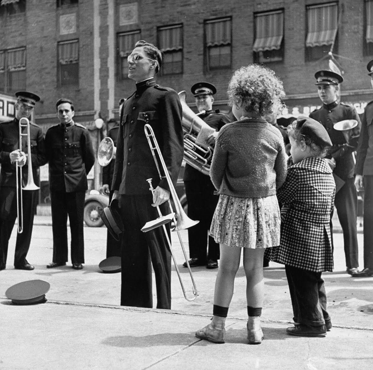 The Salvation Army band playing their instruments on the city street