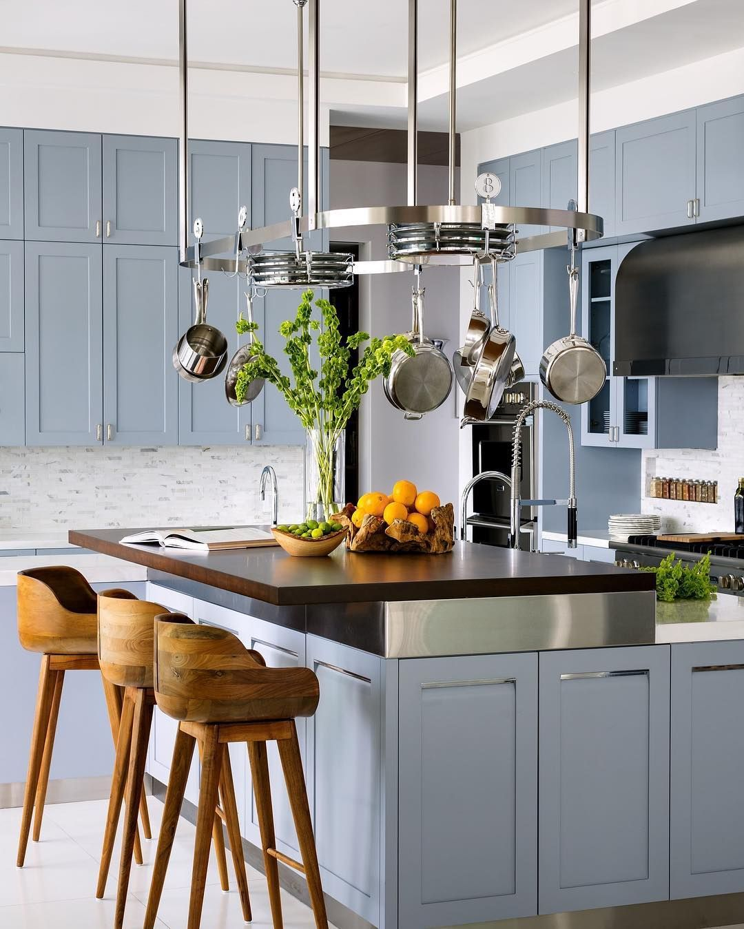 """ELLE Decor on Instagram """"A pale blue shade on the kitchen walls ..."""