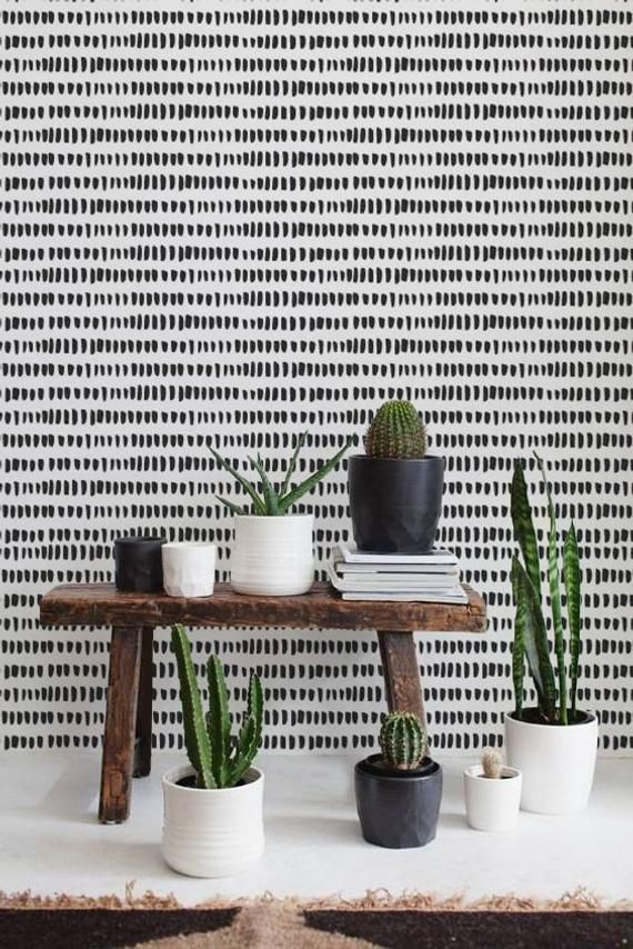 Wallpaper with black brush stroke pattern on a white