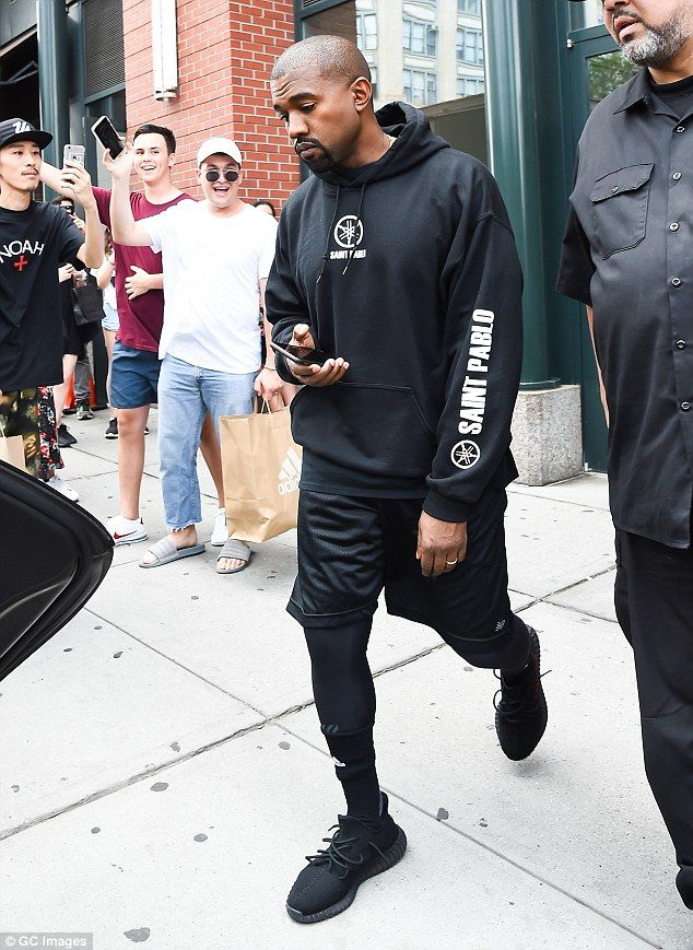 02ea81e7139b Walking advertisement: The 39-year-old rapper donned a black Saint Pablo  tour hoodie, which he initially paired with black athletic shorts and  sports ...