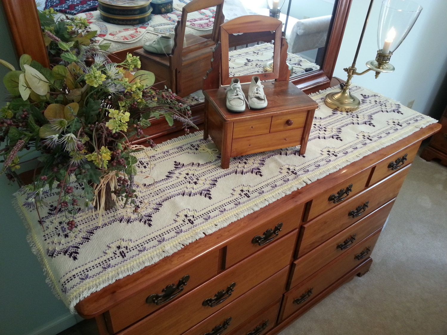 overawe dresser runner and there is a small box and mirror