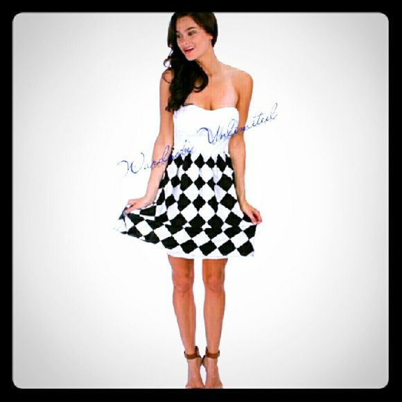 White Checkered strapless dress White sweetheart halter top  The bottom is black and white checkered  chifdon like material   Perfect for day or night! Dresses Strapless