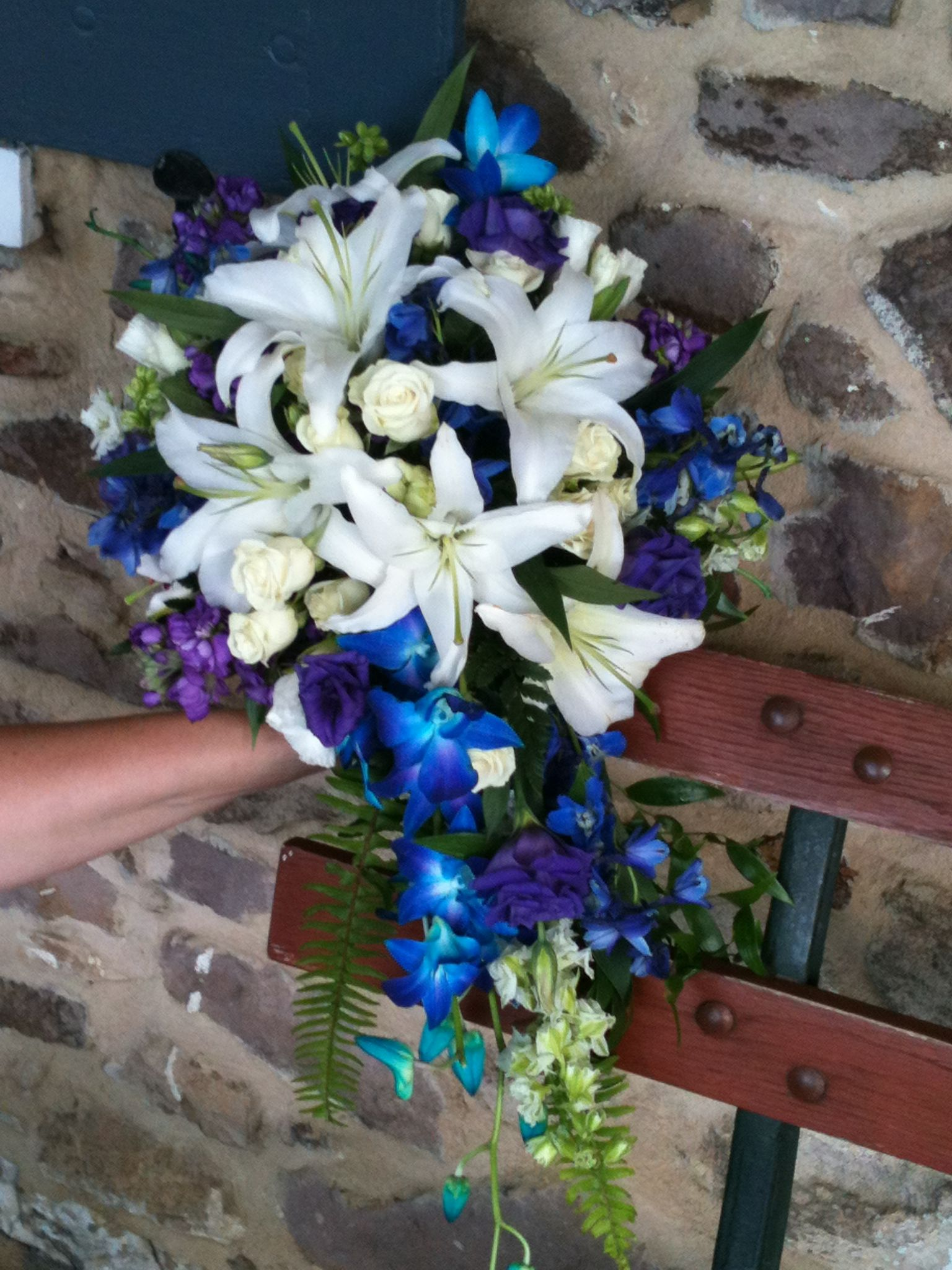 Gorgeous cascade of white lilies and blue dendrobium orchids