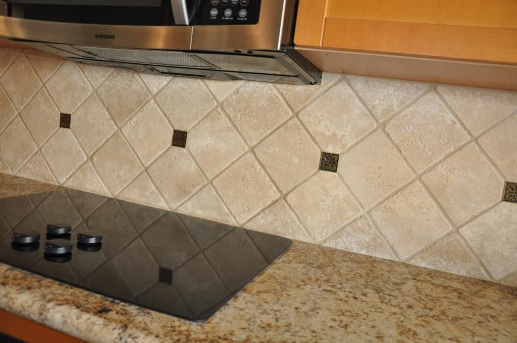 Travertine Tile Set In Diamond With Metal Tile Accents For Backsplash. Good Looking
