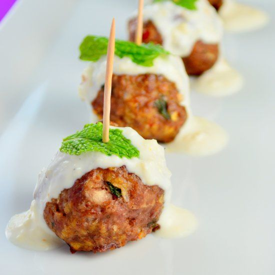 Spicy curry lamb meatballs with a creamy honey ginger yogurt sauce.