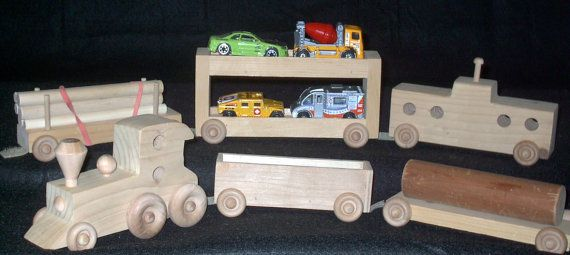 Six piece wooden train set. Pieces are connected by by TurnersToys