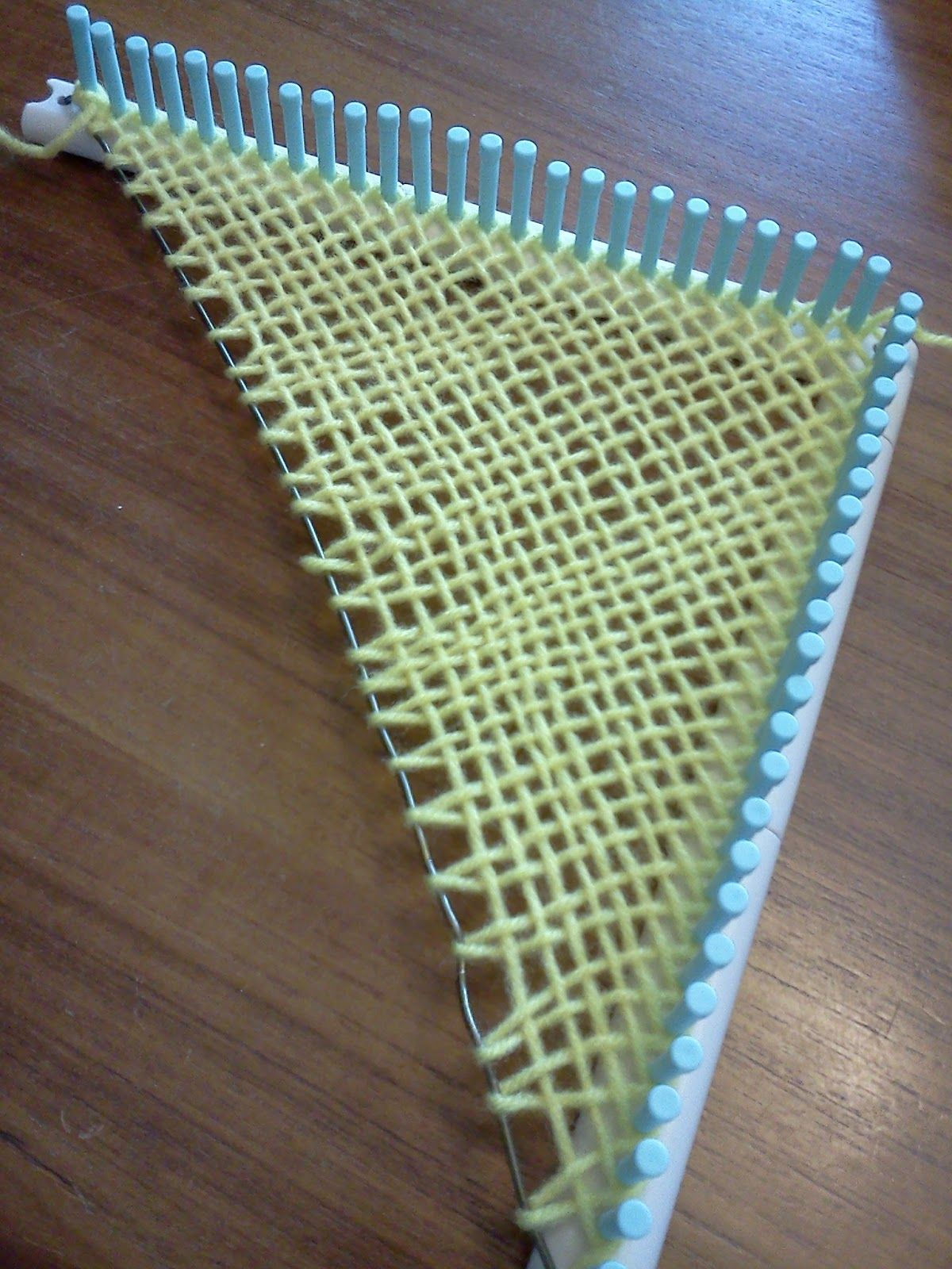 Using the Martha Stewart loom and a coat hangar to weave a triangle ...
