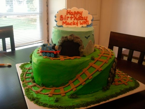 Cute train cake love the tracks going up the cake and into the