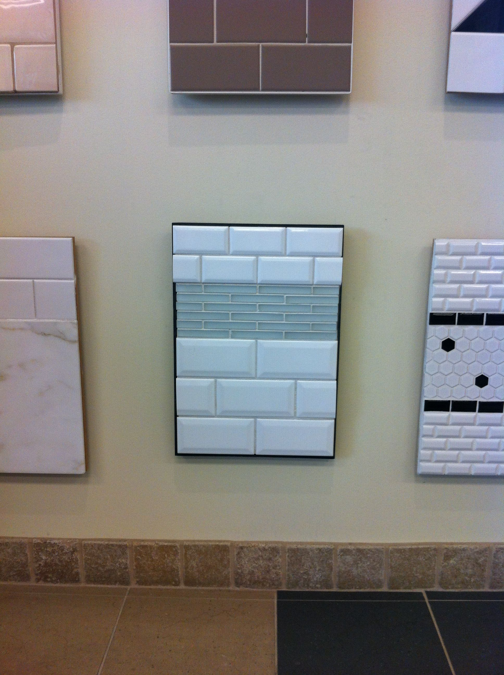 like subway tile w/blue glass insert too...cheaper than marble ...