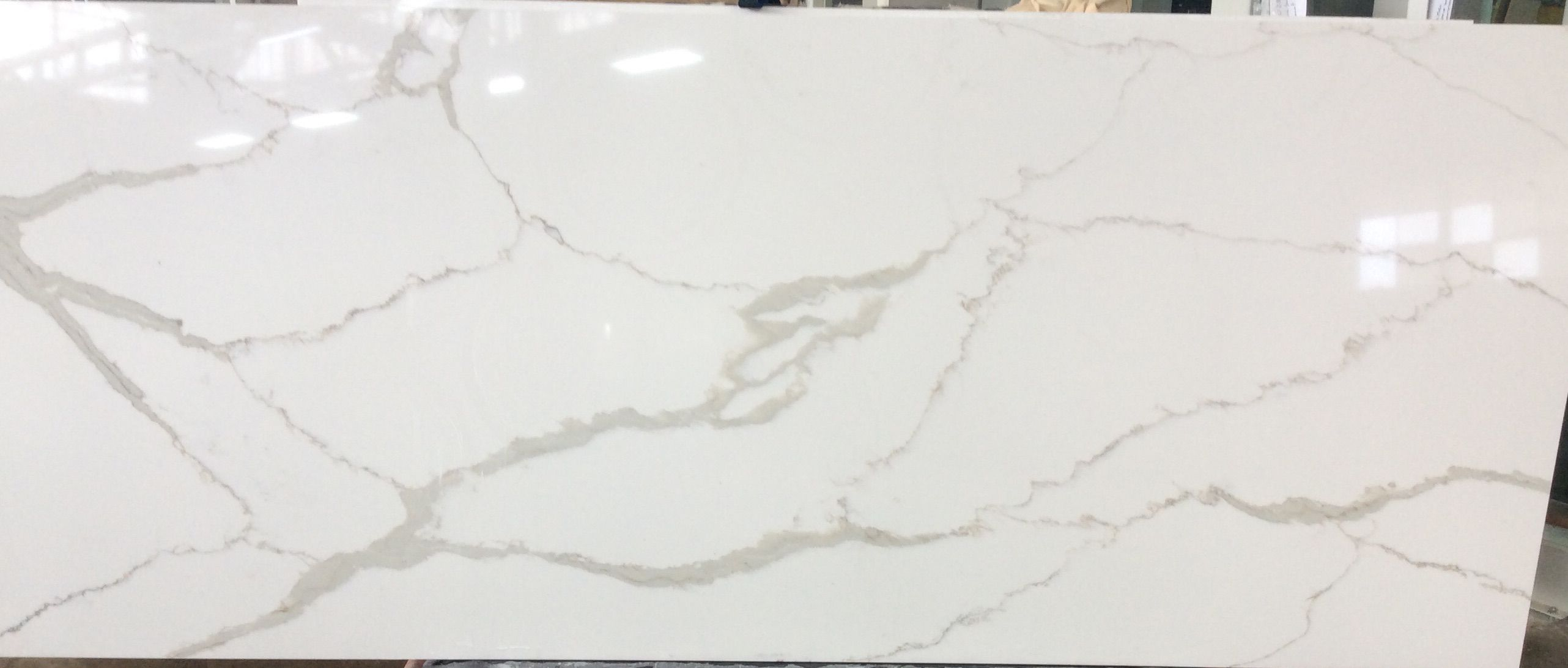 Zodiaq Calacatta Natura Quartz Backsplash Countertops Bath Showroom Oak
