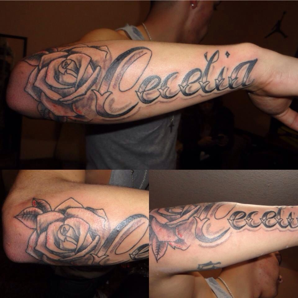 Forearm name tattoo