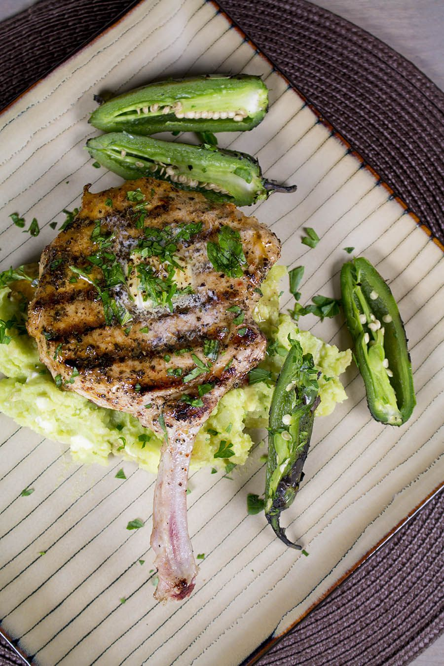 Grilled Pork Chops Over Avocado-Potato Smash with Roasted Jalapeno Peppers. #avocado #porkchop