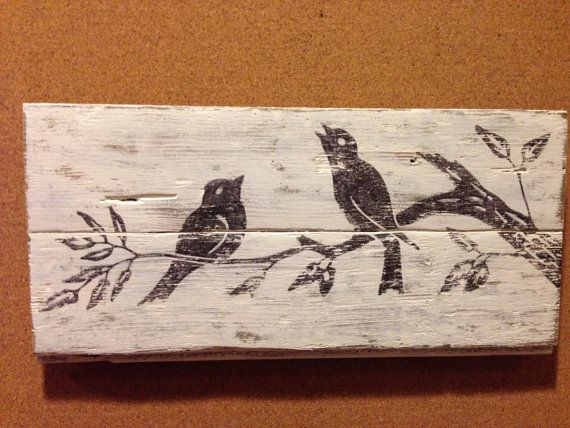 Reclaimed wood wall art with vintage bird graphic
