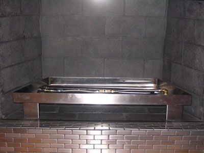 Great stainless steel pan and stainless steel surround! For propane or natural gas fireplace.