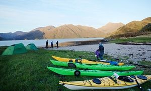 Kayaks parked and tents pitched in Scotland.