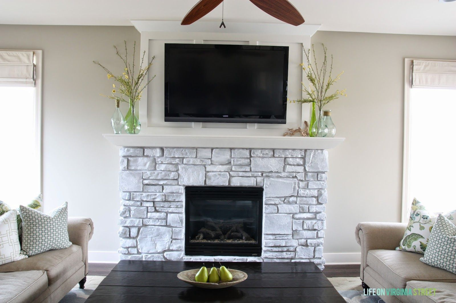 A White Washed Stone Fireplace Tutorial Life On Virginia Street White Stone Fireplaces Painted Stone Fireplace Stone Fireplace Makeover
