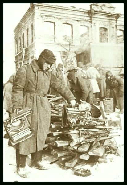 Stalingrad, Feb 1943. Russian soldiers taking stock of the German belongings.
