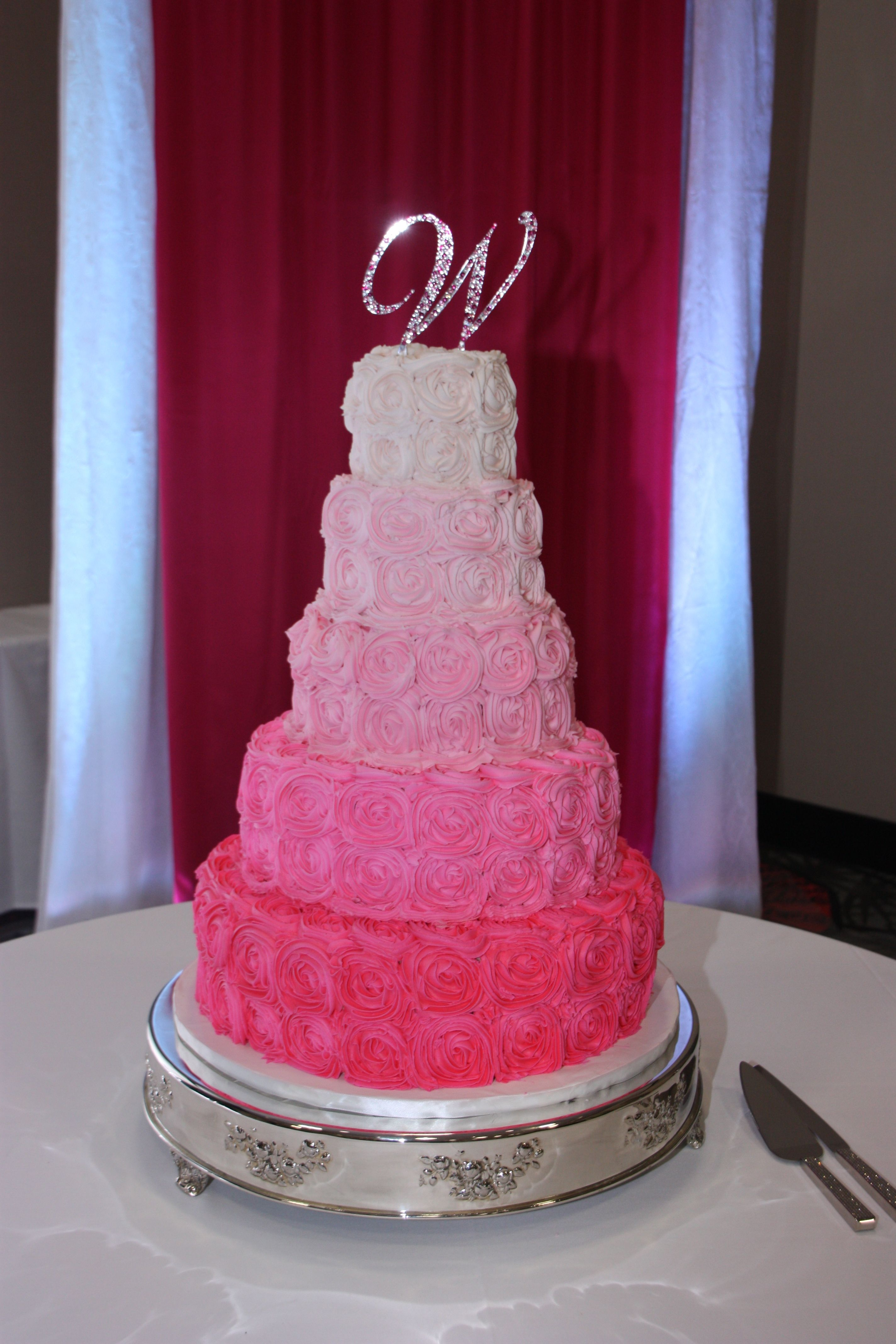Pink Rosette Wedding Cake - White cake with different shades of pink ...