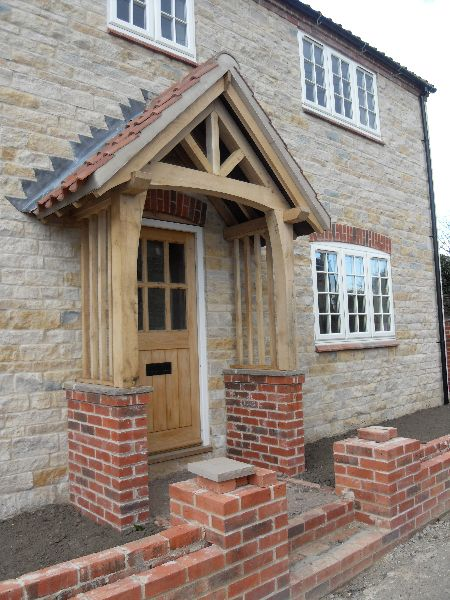 Oak porch canopy google search side door pinterest for Front porch roof kits