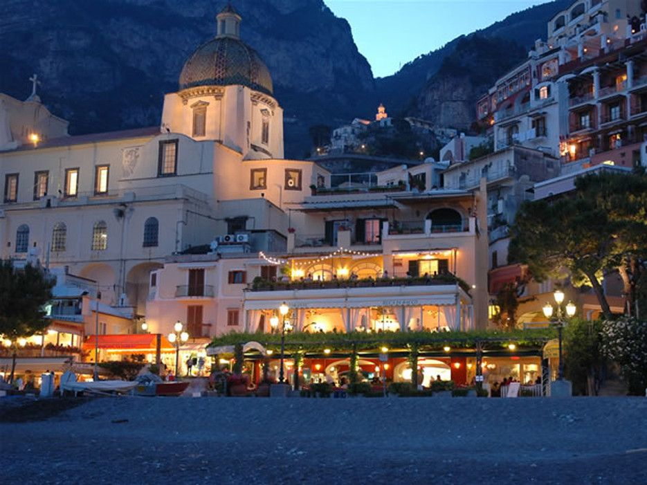 Readers' Rating: 83.869Framed by rocky hills on the sandy shores of Spiaggia Grande, this hotel makes for the perfect Positano beach getaway—the ocean is literally steps from your door. Rooms are understated, but the spectacular Tyrrhenian sea views make up for it. The Buca di Bacco restaurant, which serves up innovative Amalfi Coast-inspired cuisine, is locally-loved.