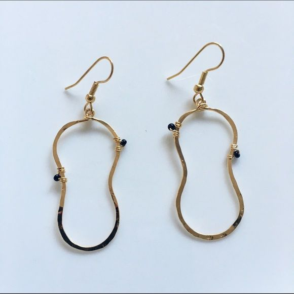 Hammered Gold  plated  Drop  earrings. Gold  plated Drop  earrings with tiny black beads. The metal is hammered so it attracts light very nicely. Never worn sample . Jewelry Earrings