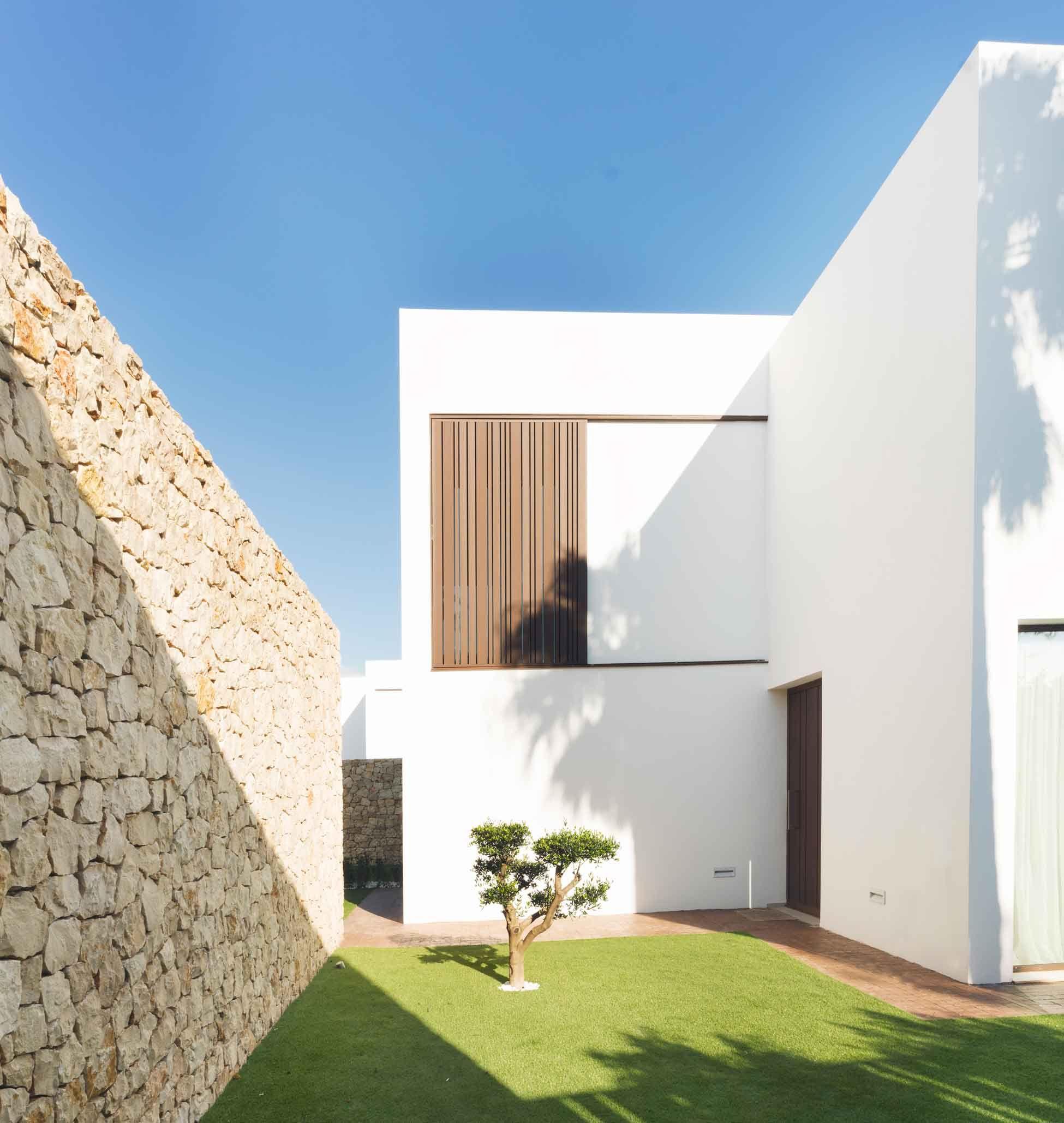 Vivienda minimalista de estilo mediterr neo great houses for Viviendas estilo minimalista
