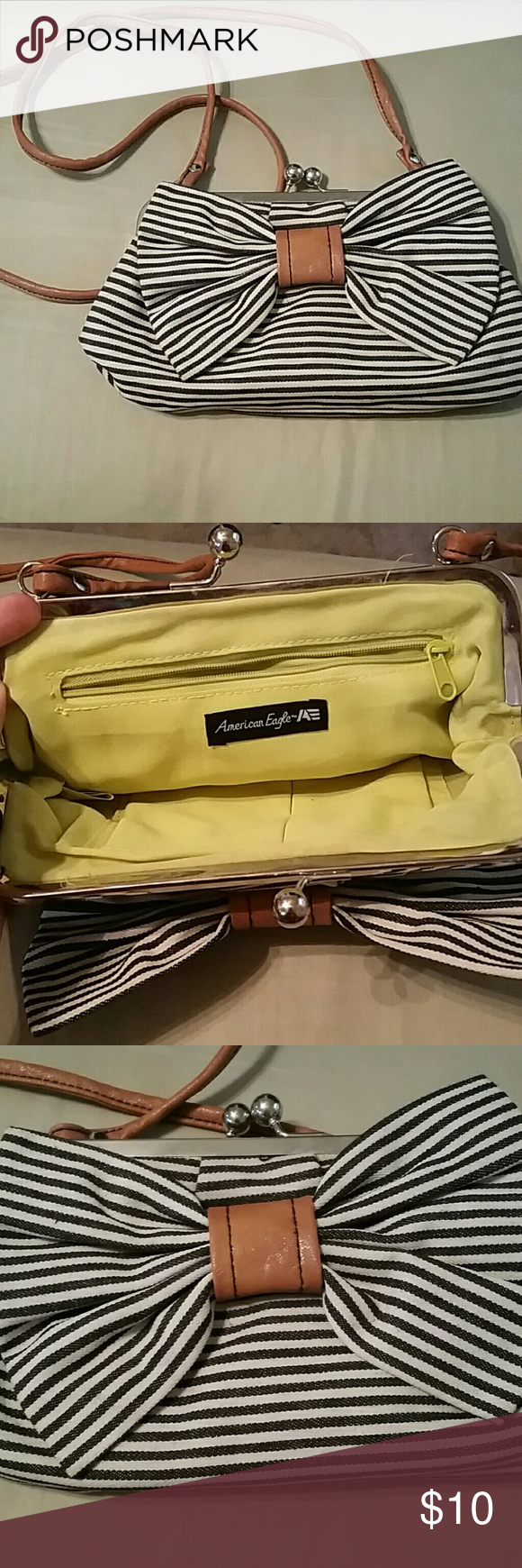 Cross body Bag Who doesn't love a bag with a bow? This blue/white bag looks ADORABLE with a casual jean outfit & the bright lime green on the inside gives a pop of color. American Eagle by Payless Bags Crossbody Bags