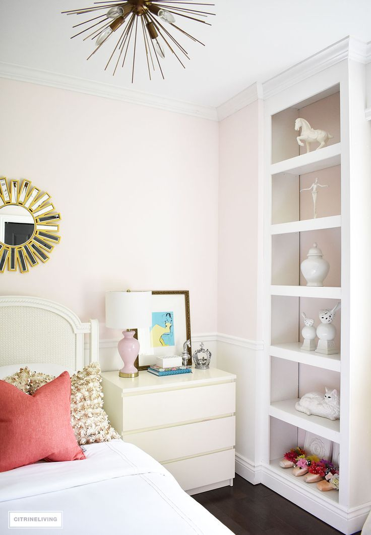 A Chic, Modern Girlu0027s Bedroom Featuring Blush Pink Walls, Coral And Brass  Accessories And