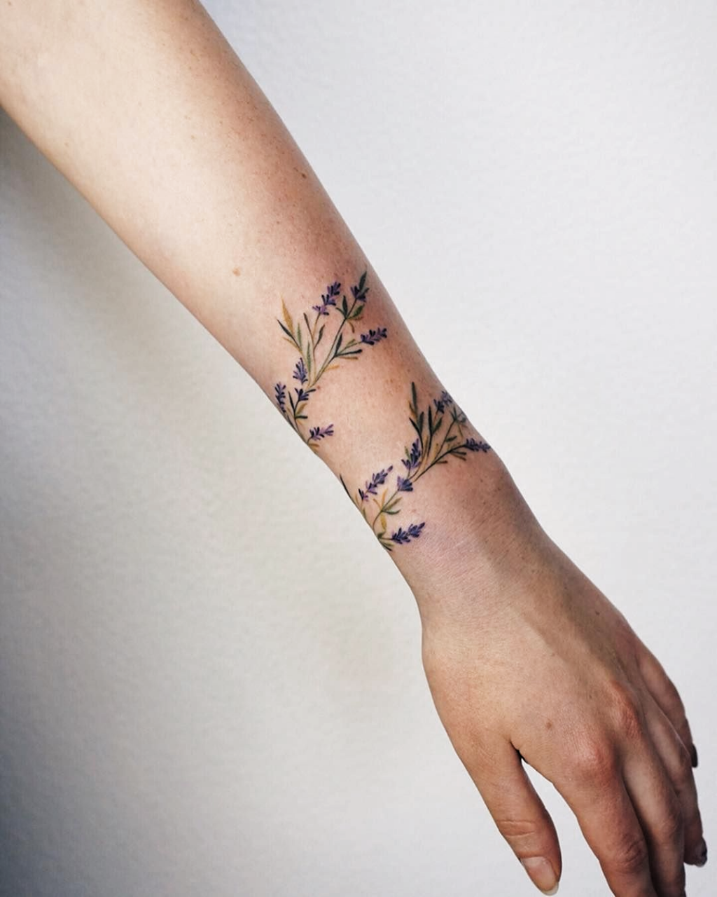 Pin By Jaclyn Bates On Tatoeage In 2020 Lavender Tattoo Wrap Around Wrist Tattoos Wrist Tattoos For Guys