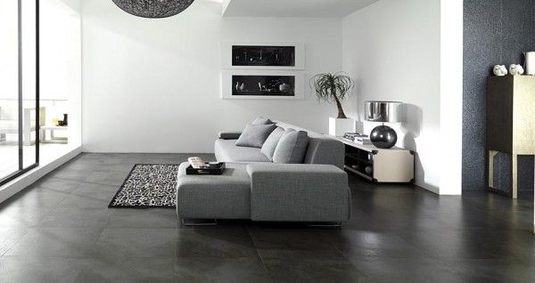 These Dark Stone Tile Floors Create Contrast With The Bright White Walls And Gray Furnishings The D Grey Tiles Living Room Living Room Tiles Living Room White