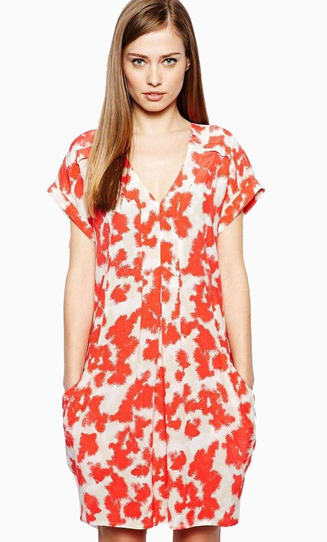 Made from lightweight, woven fabric. V-shaped neckline. Slanted pockets to front. Short sleeves. Rela...
