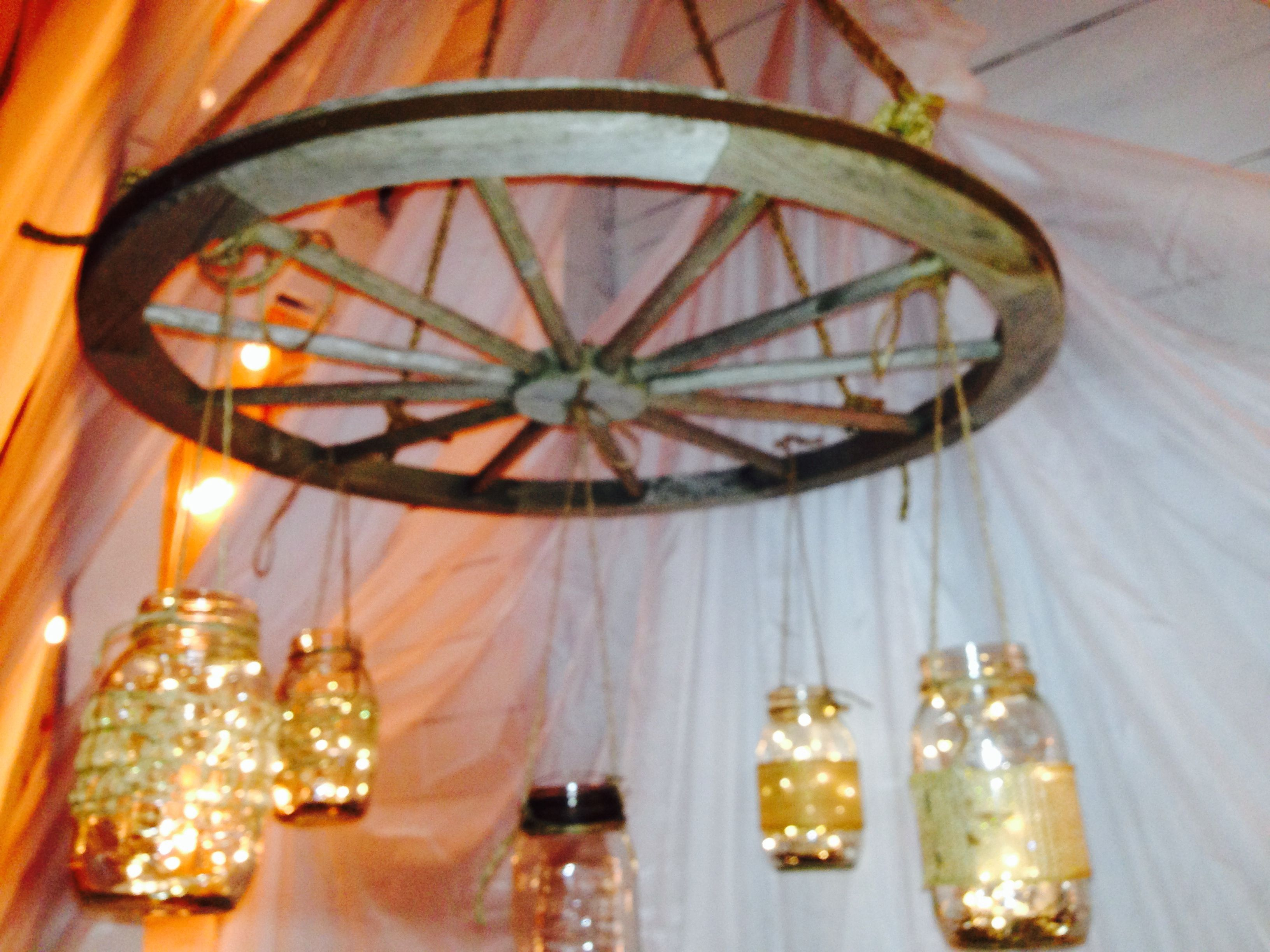 Wagon Wheel chandelier with hanging mason jars Battery operated