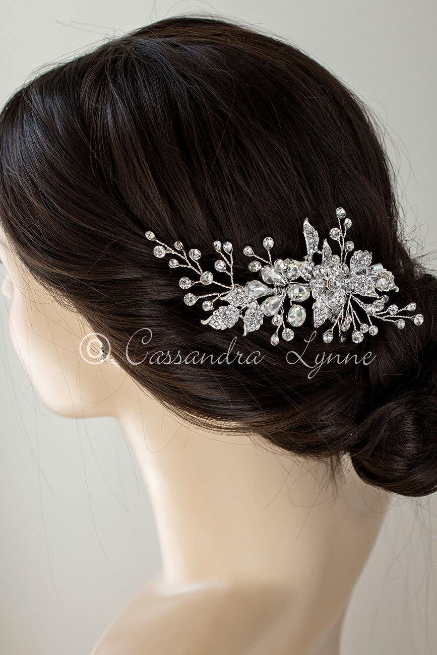 484cd40fb This stunning wedding hair clip is the perfect hair piece for the bride on  a budget! Rhinestone covered leaves, larger multi shape jewels and sprays  of more ...