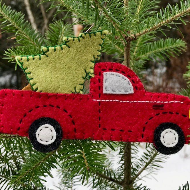 Vintage red pickup with Christmas tree ornament. My latest