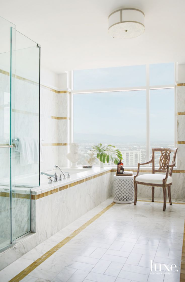 Gold and White-Stone Master Bathroom with Thoughtful Accents