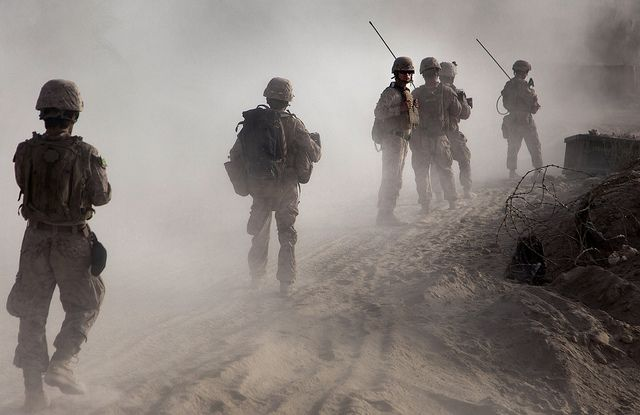 Through the dust and haze come the Marines.