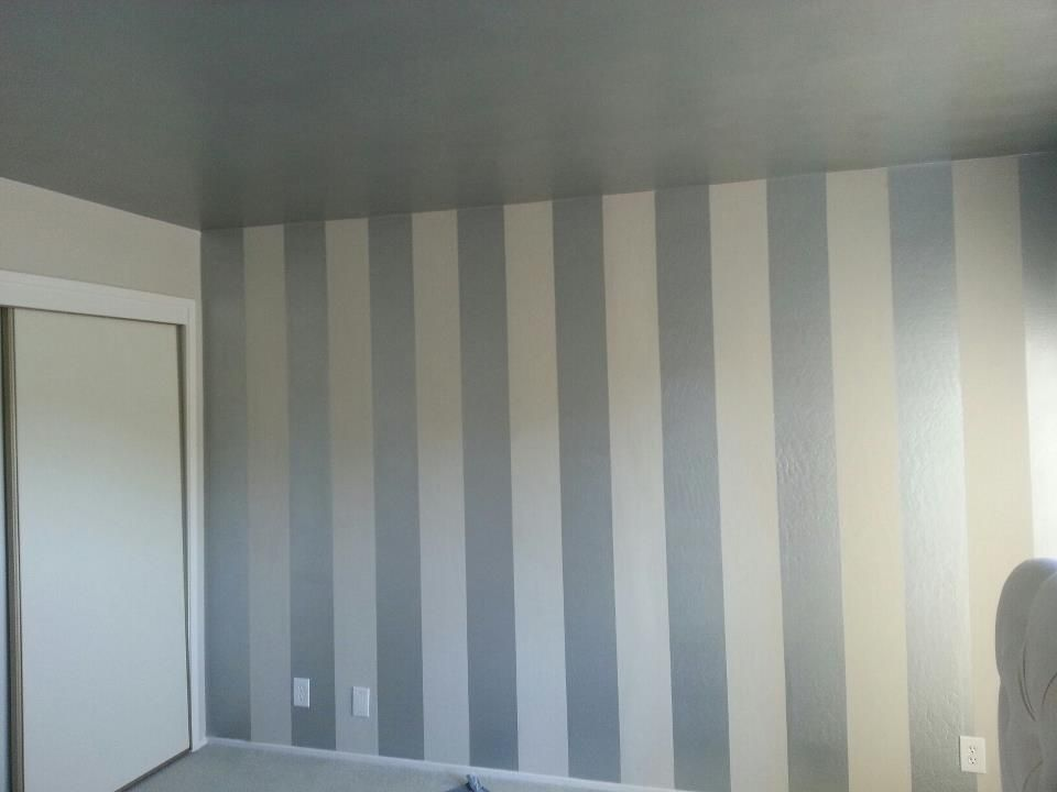 Diy interior painting vertical stripes make ceilings look for Bedroom stripe paint ideas