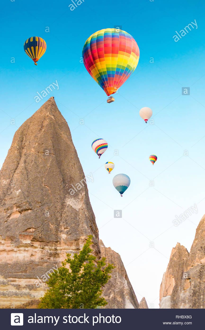 Colorful hot air balloons flying over at fairy chimneys in