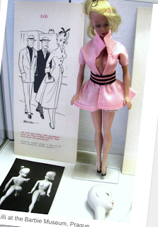 The Handlers did a little shopping when they took their kids to Europe in 1956. And in the window of a Men's Shop posed an image of a sex toy that you see. The doll was a gag gift and a Men's sexy novelty toy that stared in a racy comic strip in the Germany newspaper Bild Zeitung. The doll... the Bild-Lilli doll. Ruth went in and bought 2. One for her daughter and one for the team back home in America. And from her prototype Barbie was born...