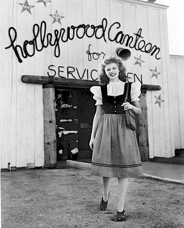 Rita Hayworth outside of The Hollywood Canteen for Servicemen. Here, Hollywood stars fed and entertained soldiers during WWII.