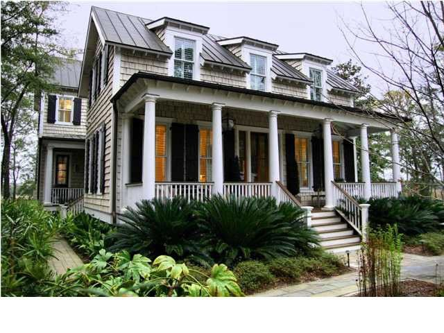 Cottage Home. Tin Roof. Dormers. Shutters. Landscaping. Front Porch.