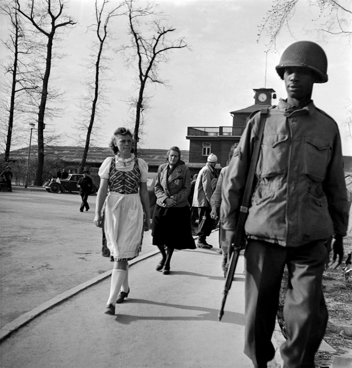 An american soldier leads german civilians from weimar and the surrounding areas into buchewald concentration camp