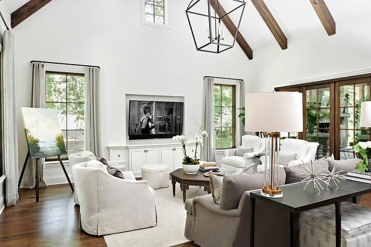 A Darlana Medium Lantern Is Hung From Vaulted Ceiling Accented