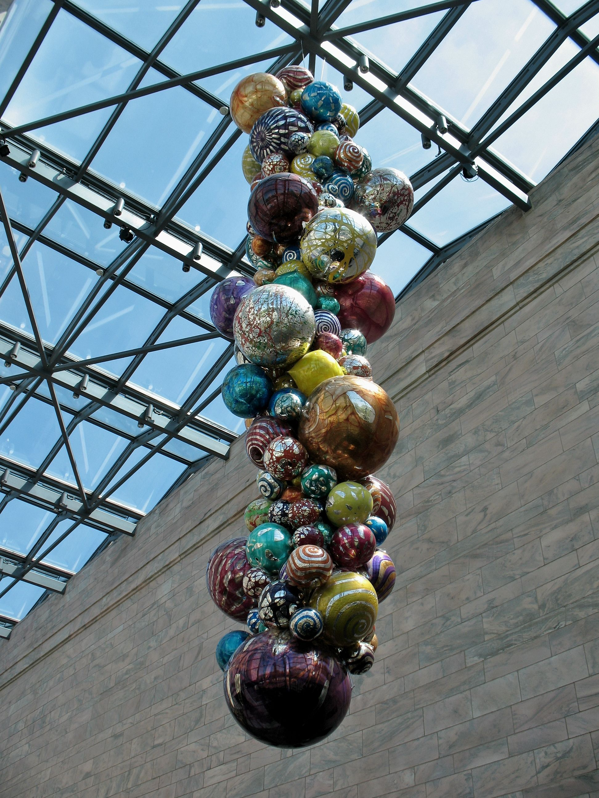 Polyvitro chandelier by Dale Chihuly over cafe in Atrium of Joslyn