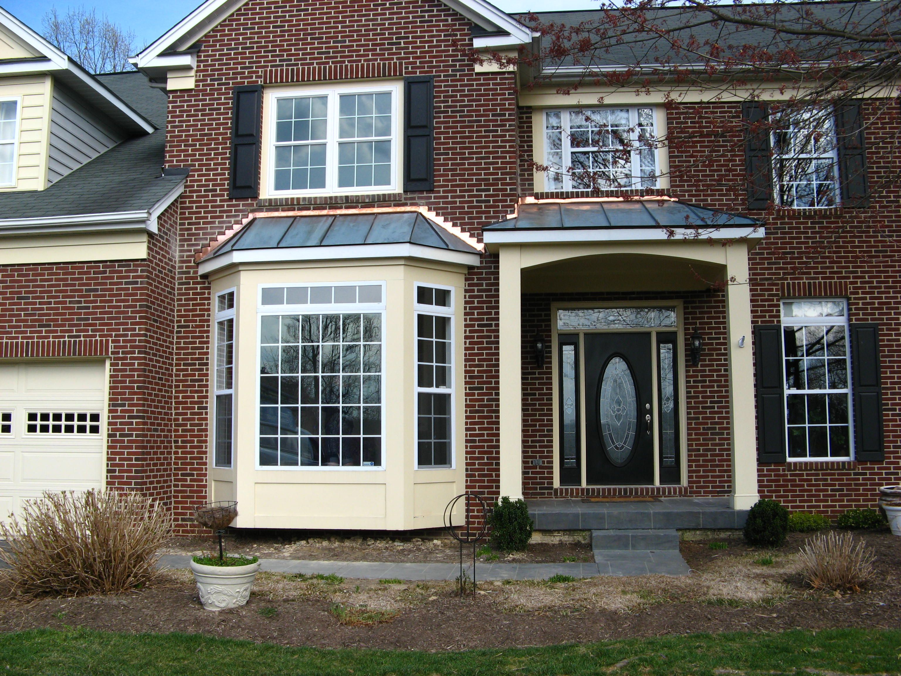 Entry Portico And Walk Out Bay Window With Copper Roofs Bay Window French House Copper Roof