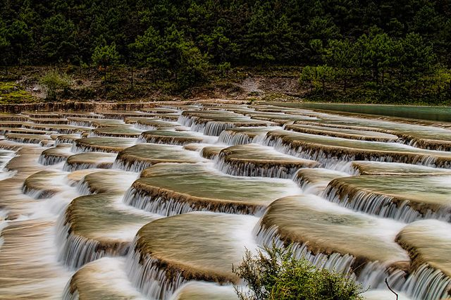 Step Falls scenic point at the Yulong snow mountain park in Yunnan, China. by `James Wheeler