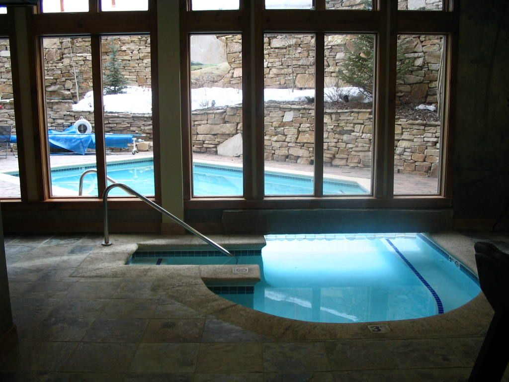 Having an indoor outdoor pool on your property is a lot of for Indoor garden pool