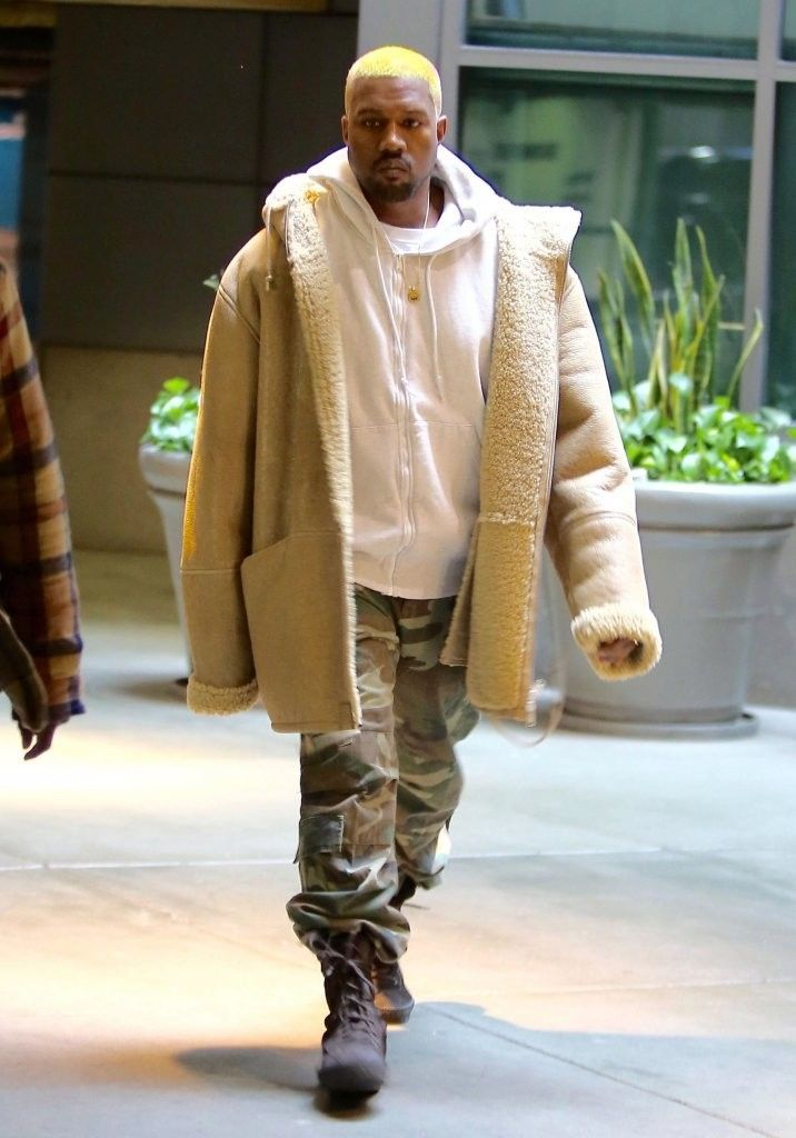 421d2284b2841 Kanye West Leaves Movie Theater Wearing Yeezy Season Shearling Coat and  Boots