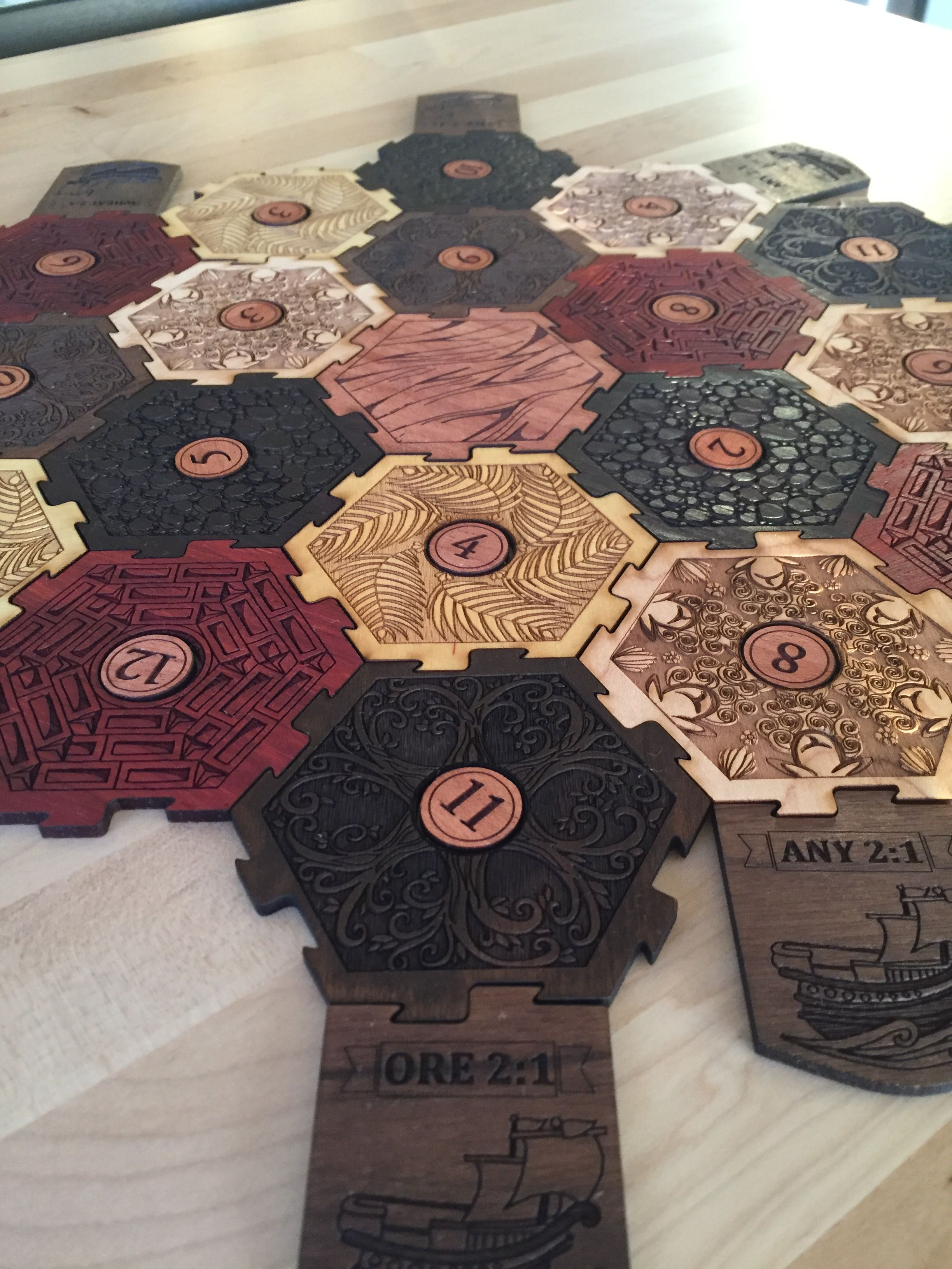 A Settlers of Catan set. Took about 15 hours to laser-cut and finish all the pieces.